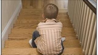 Generic child sitting on steps
