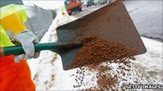 Workers shovelling grit