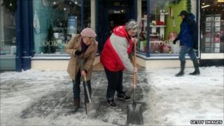 Shopkeepers clear snow in Wells on 20 December