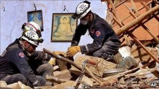 Rescue workers at the quake site in January 2001
