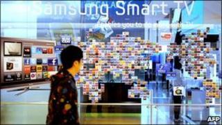 Man walks past Samsung stand