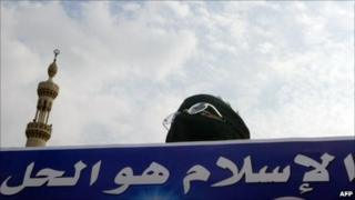 "Muslim Brotherhood supporter holds a banner saying: ""Islam is the solution"" (2005)"