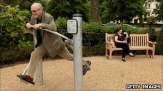 Pensioner in a playground for the elderly