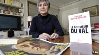 Fabienne Boulin-Burgeat, Robert Boulin's daughter, poses at her home with her book about his death, The Sleeper In The Valley, 25 January 2011