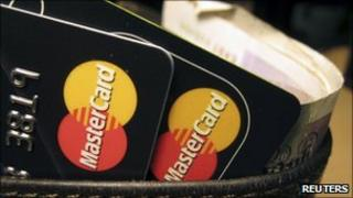 Mastercard credit cards seen in a wallet