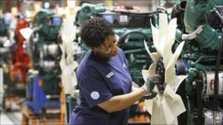 Production worker fits a fan on a truck engine at the Volvo plant in Dublin, Virginia, US