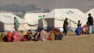 In this photo taken on Jan. 31, 2011 Pakistani displaced people arrived at a camp set up in Naghi, 18 kilometers (11 miles) northwest of the Afghanistan border in the Pakistani tribal area of Mohmand