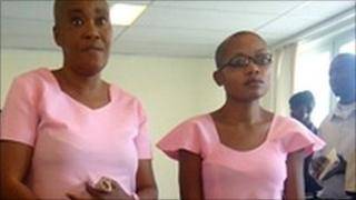 Saidath Mukakibibi (left) and Agnes Nkusi (right) in pink prison uniforms in court on 5 January 2011