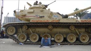Protester and tank in Tahrir Square