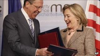 Sergei Lavrov and Hillary Clinton exchange New Start treaty documents. 5 Feb 2011