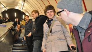 Emma Cherry, Chris Athorne, Stefan Vincent, Chris Francis, Henry Homesweet and MC Truth on an escalator