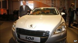 A Peugeot executive shows off the new 508