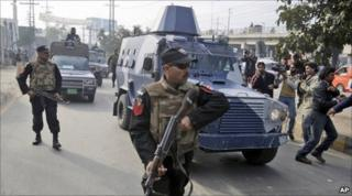 An armoured car carrying Raymond Davis leaves a court in Lahore on 11 February 2011