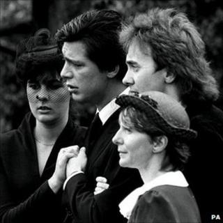 Jeremy Bamber, pictured second left, at a funeral following the Essex farmhouse killings. His then girlfriend Julie Mugford is pictured far left.