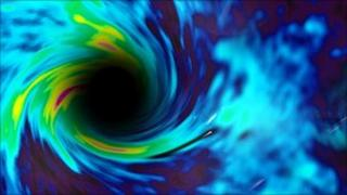 Artist's Impression of spinning black hole (Courtesy B Thide)