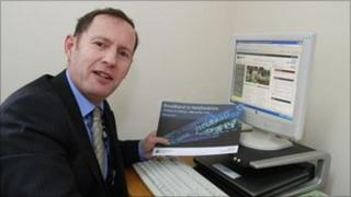 Cllr Roger Phillips with the new broadband strategy