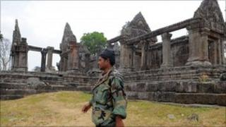 A Cambodian soldier walks past the Preah Vhear temple