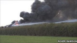 Smoke billowing from factory on fire
