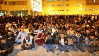 Protesters pray for injured comrades outside Salmaniya hospital, Manama, late on 17 February