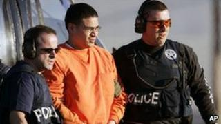 Jose Padilla (in orange prison suit) is escorted for trial in Miami, January 2006