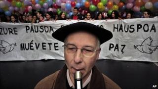 A Basque musician plays the Txistu, a typical Basque instrument, at a rally for peace in Bilbao on 29 January 2011