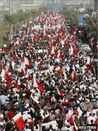 Tens of thousands of people march through the capital Manama in a rally calling for democratic reforms