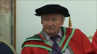TP Flanagan in gown and cap