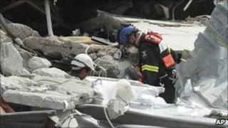 Specialist teams sift through the destroyed CTV building in Christchurch on Thursday 24 February