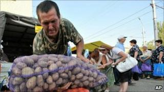 A man carrying potatoes in Stavropol, Russia