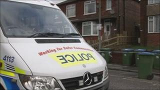 A police van outside the house in Broadlands Road
