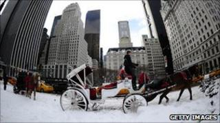Horse-cart waits for customers in New York after heavy snow