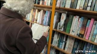 Woman browses book in library