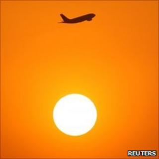 Passenger jet and the Sun