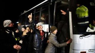 Illegal migrants are put on a coach in Lampedusa, 2 March