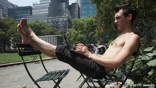 Man using laptop in Bryant Park, NYC