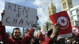Protesters in Tunis hold a banner in French which reads: Nothing has changed. Photo: February 2011
