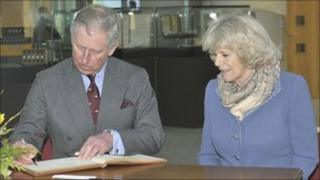 Prince Charles and Camilla, The Duchess of Cornwall sign the visitors book at GCHQ