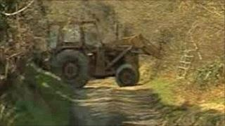 Tractor blocking access to path at Cwm Farm at Blaenycoed in Carmarthen