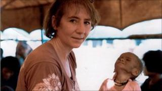 Anne Watts with a sick child in Sa Keao, Thailand