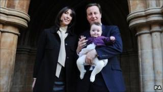 Prime Minister David Cameron and his wife Samantha with their daughter Florence