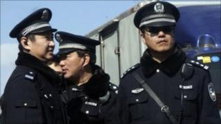 Chinese police officers stand on duty near the Xidan shopping district