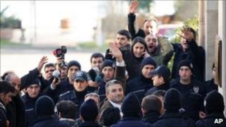 Turkish journalists Nedim Sener (C) and Ahmet Sik (far L) arrive in court (5 March 2011)