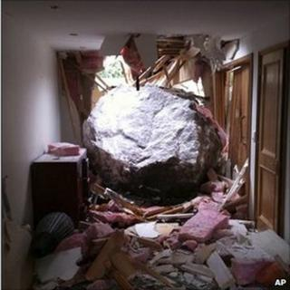 In this photo taken 1 March 2011, a car-sized boulder is seen after smashing into Phil Johnson's house in last month's earthquake in Christchurch