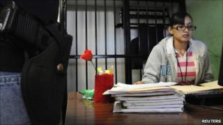 Marisol Valles Garcia talks to a colleague in Praxedis G. Guerrero in this October 29, 2010 file photo.