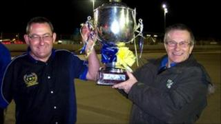 Buster Chapman (left) and Derek Howard (right) celebrate with a King's Lynn Stars speedway trophy at the Norfolk Arena