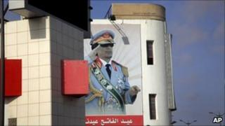 Giant mural of Libyan leader Gaddafi hangs on a building in Tripoli, 8 March 2011