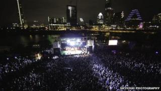 Hoards of SXSW attendees at an outside concert
