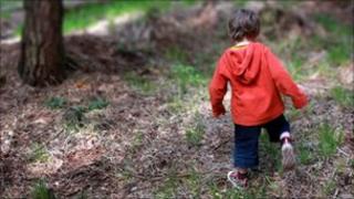 Boy walking in woodland