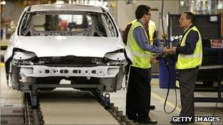 A 2011 Ford Focus goes through the assembly line at the Ford Michigan Assembly Plant