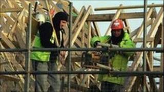 Workers building new houses